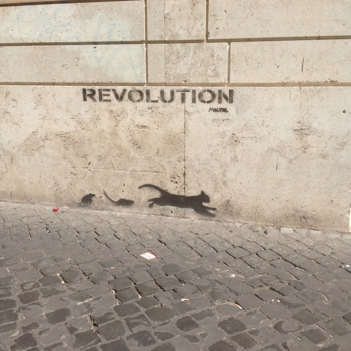 Cat being chased - street art in Rome