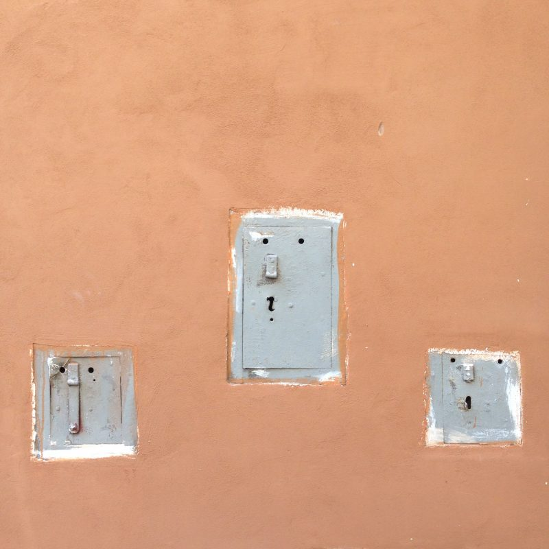 Switches with faces in on a wall in Rome Italy