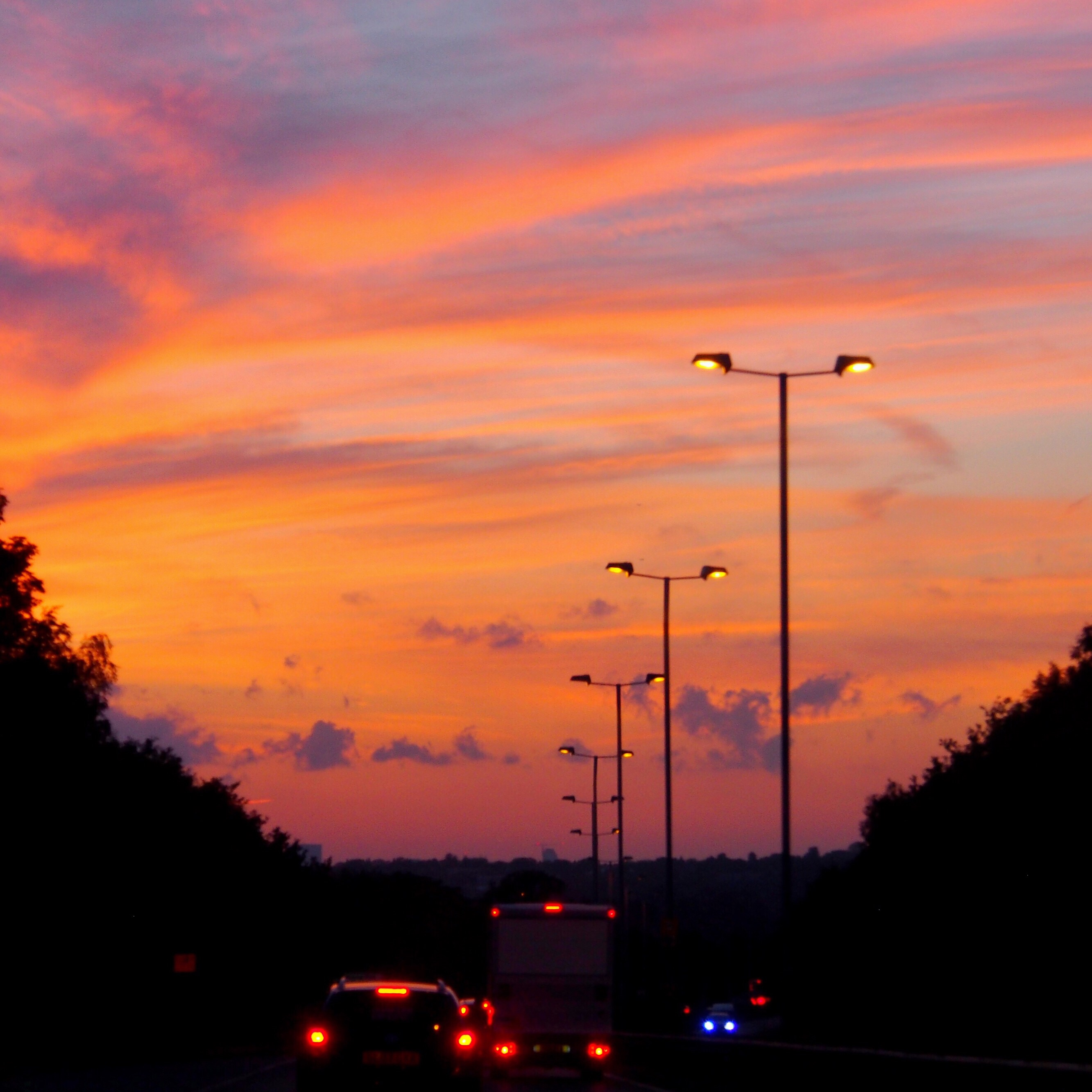 Pink and purple sunset driving back into London | Conversation Pieces